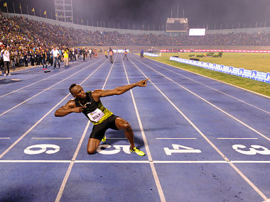 Usain Bolt of Jamaica celebrates after running his final race in home country during the Racers Grand Prix at the national stadium in Kingston, Jamaica, on June 10, 2017. Bolt partied with his devoted fans in an emotional farewell at the National Stadium on June 10 as he ran his final race on Jamaican soil. Bolt is retiring in August following the London World Championships. / AFP PHOTO / Ricardo Makyn